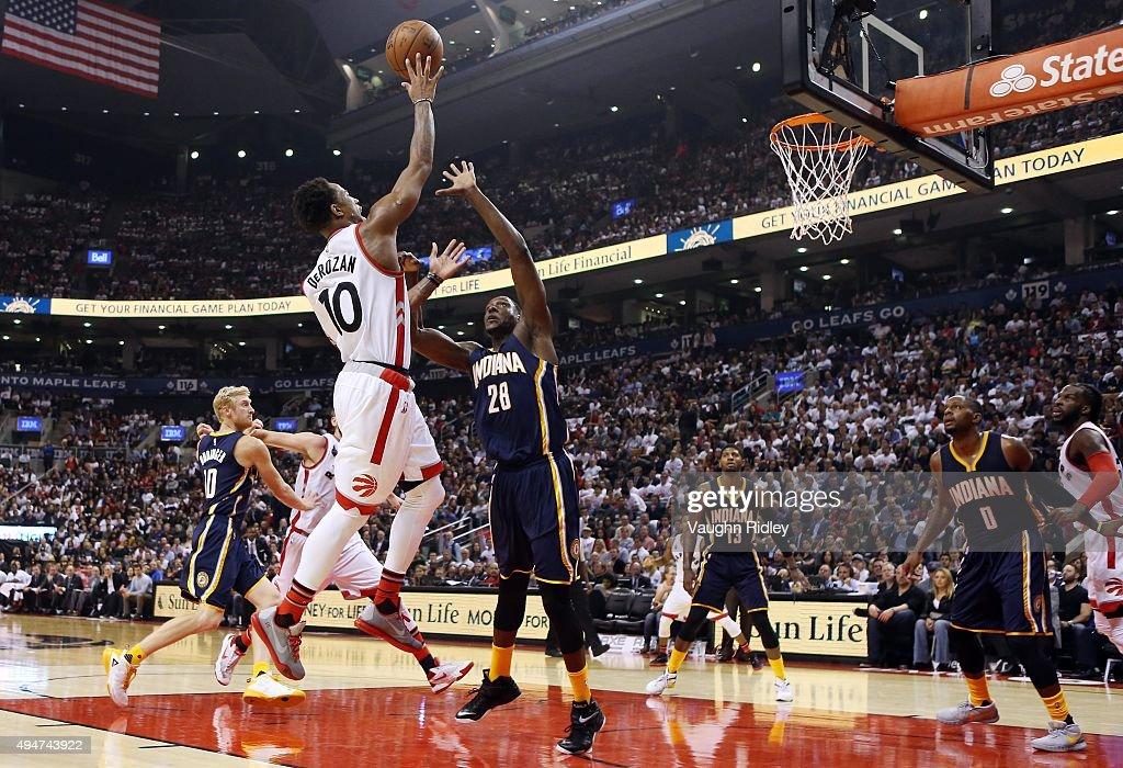 DeMar DeRozan #10 of the Toronto Raptors shoots the ball as <a gi-track='captionPersonalityLinkClicked' href=/galleries/search?phrase=Ian+Mahinmi&family=editorial&specificpeople=740196 ng-click='$event.stopPropagation()'>Ian Mahinmi</a> #28 of the Indiana Pacers defends during the NBA season opener at Air Canada Centre on October 28, 2015 in Toronto, Ontario, Canada.