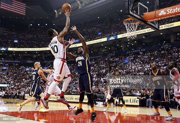 DeMar DeRozan of the Toronto Raptors shoots the ball as Ian Mahinmi of the Indiana Pacers defends during the NBA season opener at Air Canada Centre...