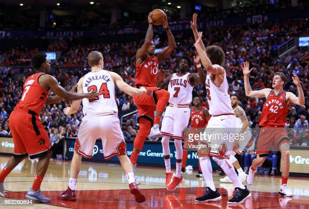 DeMar DeRozan of the Toronto Raptors shoots the ball as Lauri Markkanen Justin Holiday and Robin Lopez of the Chicago Bulls defend during the second...