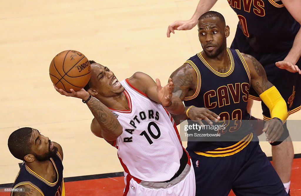 DeMar DeRozan #10 of the Toronto Raptors shoots the ball as <a gi-track='captionPersonalityLinkClicked' href=/galleries/search?phrase=LeBron+James&family=editorial&specificpeople=201474 ng-click='$event.stopPropagation()'>LeBron James</a> #23 of the Cleveland Cavaliers reacts during the second half in game three of the Eastern Conference Finals during the 2016 NBA Playoffs at Air Canada Centre on May 21, 2016 in Toronto, Canada.