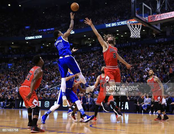 DeMar DeRozan of the Toronto Raptors shoots the ball as Robin Lopez of the Chicago Bulls defends during the first half of an NBA game at Air Canada...