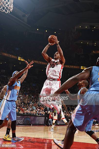 DeMar DeRozan of the Toronto Raptors shoots the ball during a game against the Denver Nuggets on October 31 2016 at the Air Canada Centre in Toronto...