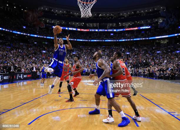 DeMar DeRozan of the Toronto Raptors shoots the ball during the first half of an NBA game against the Chicago Bulls at Air Canada Centre on March 21...