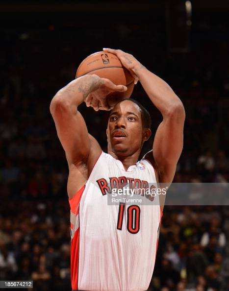DeMar DeRozan of the Toronto Raptors shoots the ball during the game against the Memphis Grizzlies on October 23 2013 at the Air Canada Centre in...