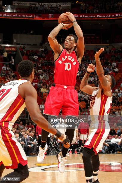 DeMar DeRozan of the Toronto Raptors shoots the ball during the game against the Miami Heat on March 23 2017 at AmericanAirlines Arena in Miami...