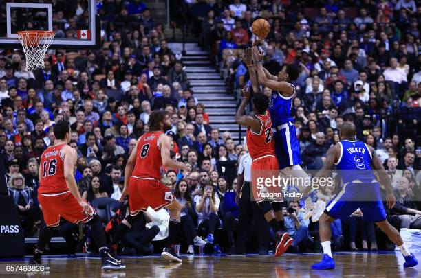 DeMar DeRozan of the Toronto Raptors shoots the ball during the second half of an NBA game against the Chicago Bulls at Air Canada Centre on March 21...