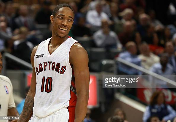 DeMar DeRozan of the Toronto Raptors smiles near the end of the game against the Oklahoma City Thunder during their game at Air Canada Centre on...