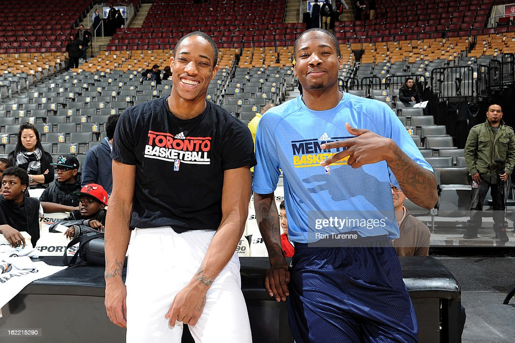 DeMar DeRozan #10 of the Toronto Raptors smiles with former teammate Ed Davis #32 of the Memphis Grizzlies before the game on February 20, 2013 at the Air Canada Centre in Toronto, Ontario, Canada.