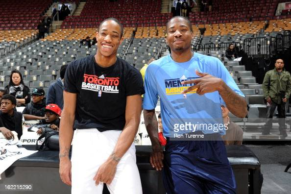 DeMar DeRozan of the Toronto Raptors smiles with former teammate Ed Davis of the Memphis Grizzlies before the game on February 20 2013 at the Air...