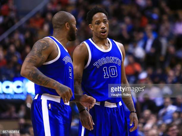 DeMar DeRozan of the Toronto Raptors speaks with PJ Tucker during the first half of an NBA game against the Chicago Bulls at Air Canada Centre on...