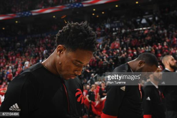 DeMar DeRozan of the Toronto Raptors stands for the National Anthem before the game against the Milwaukee Bucks in Round One of the Eastern...