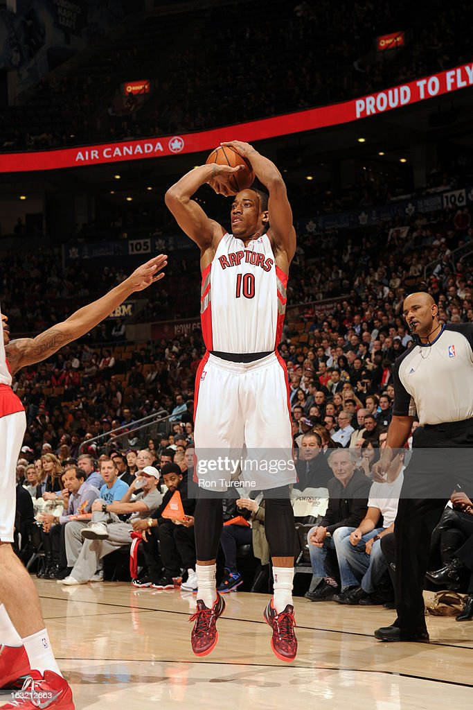 DeMar DeRozan #10 of the Toronto Raptors takes a shot against the Washington Wizards on February 25, 2013 at the Air Canada Centre in Toronto, Ontario, Canada.