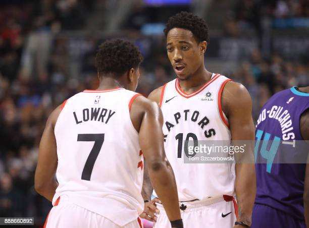 DeMar DeRozan of the Toronto Raptors talks to Kyle Lowry during a break in the action against the Charlotte Hornets during NBA game action at Air...