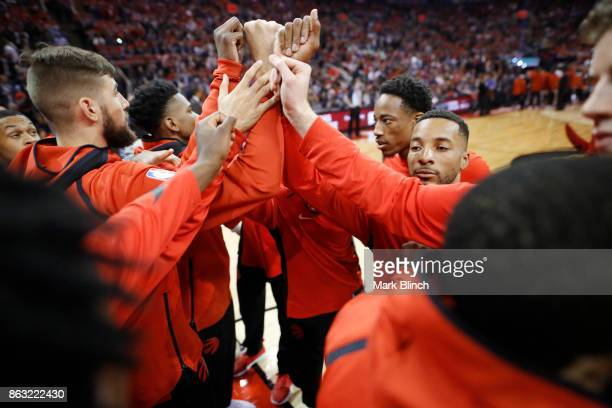 DeMar DeRozan of the Toronto Raptors with his teammates huddle before the game against the Chicago Bulls on October 19 2017 at the Air Canada Centre...