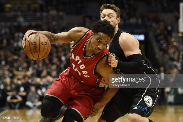 DeMar DeRozan of the Toronto Raptors works against Matthew Dellavedova of the Milwaukee Bucks during the second half of Game Three of the Eastern...