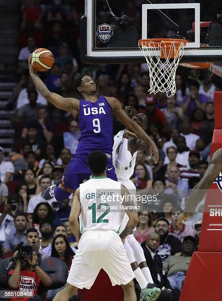 DeMar DeRozan of the United States makes a slam dunk against Nigeria in a preOlympic exhibition game during USA Basketball Showcase at Toyota Center...