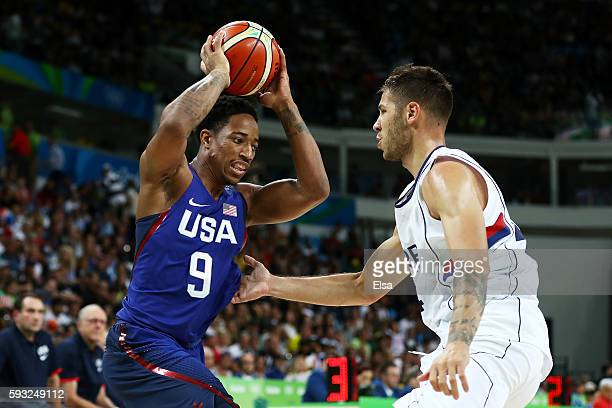 Demar DeRozan of United States drives the ball around Serbia during the Men's Gold medal game on Day 16 of the Rio 2016 Olympic Games at Carioca...