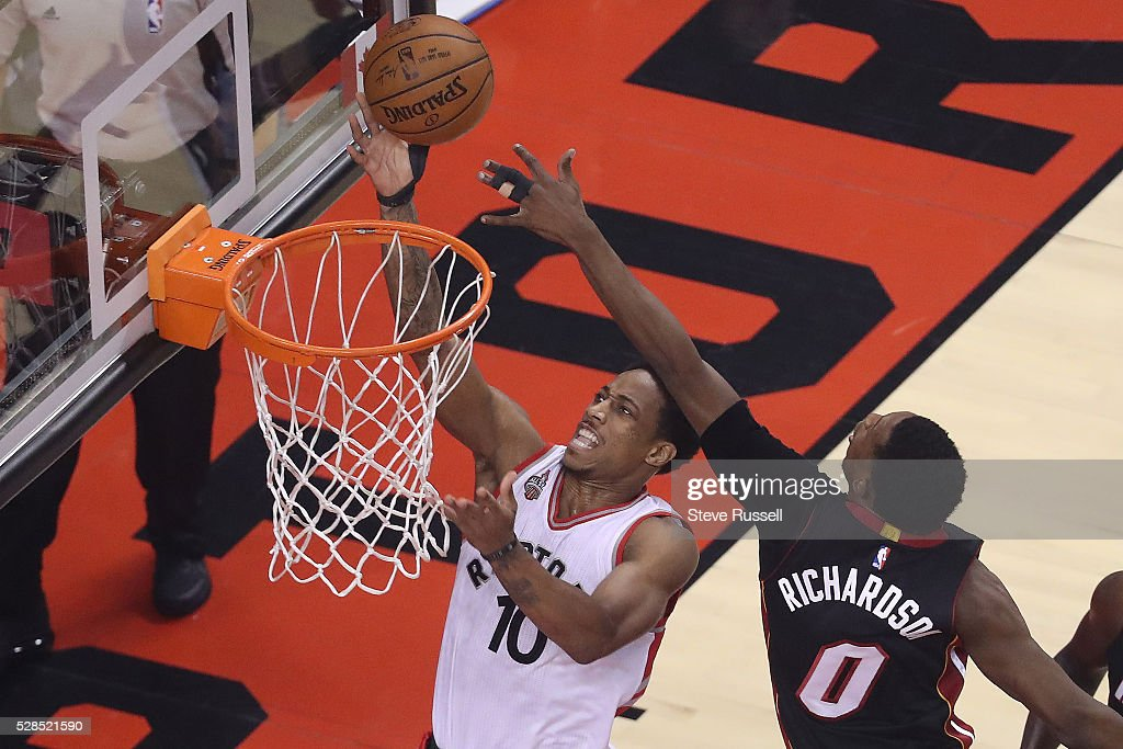 DeMar DeRozan sneaks under Josh Richardson as the Toronto Raptors play the Miami Heat in game two of their Eastern Conference Semifinal at the Air Canada Centre in Toronto. May 5, 2016.