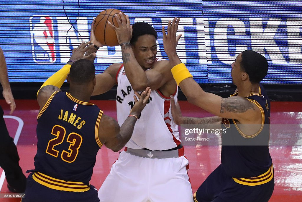 DeMar DeRozan us defended by LeBron James and Channing Frye as the Toronto Raptors beat the Cleveland Cavaliers in game 4 of the NBA Conference Finals in Toronto. May 23, 2016.