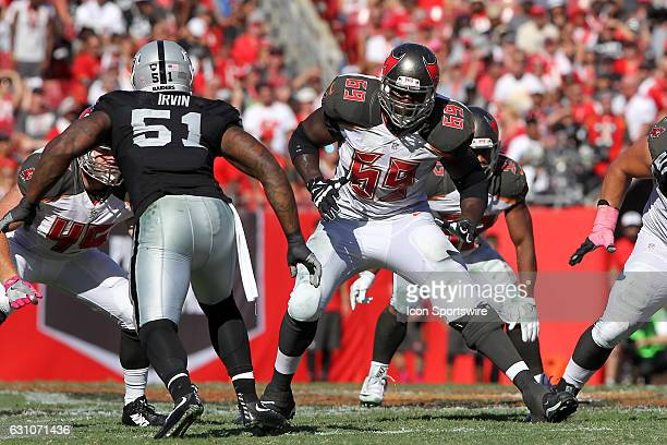 Demar Dotson of the Bucs sets up to block as Bruce Irvin attempts to go around the back side of Dotson during the NFL game between the Oakland...