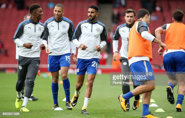 Demarai Gray Islam Slimani Riyad Mahrez and Ben Chilwell of Leicester City warm up at Emirates Stadium ahead of the Premier League match between...