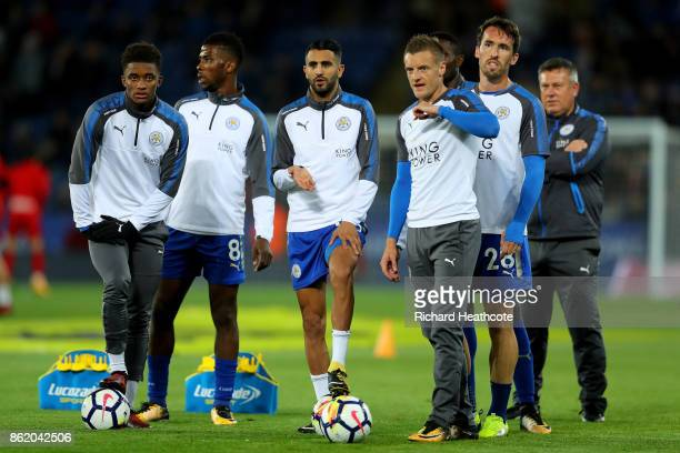 Demarai Gray Kelechi Iheanacho Riyad Mahrez Jamie Vardy and Christian Fuchs of Leicester City warm up ahead of the Premier League match between...