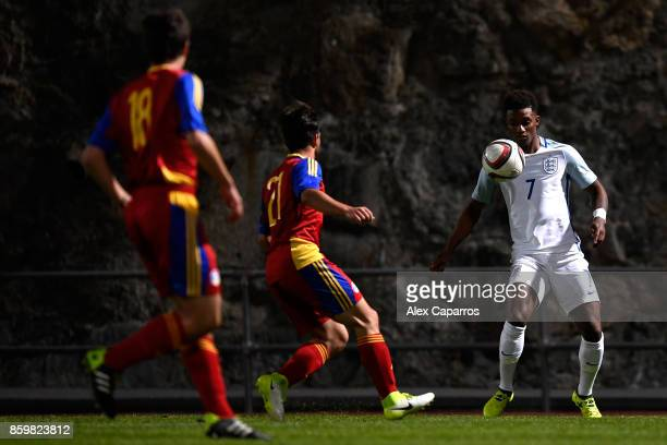 Demarai Gray of England is challenged by Sandro of Andorra during the UEFA European Under 21 Championship Qualifier between Andorra U21 and England...