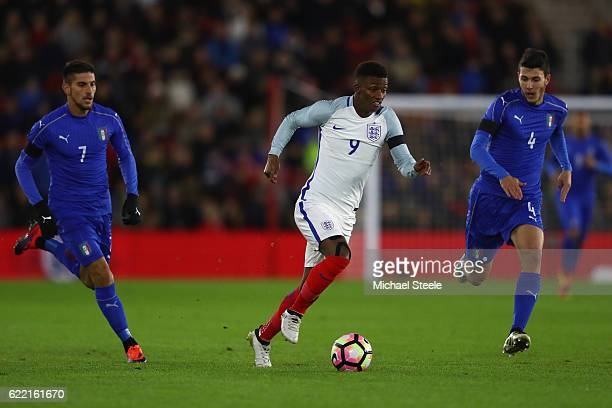 Demarai Gray of England is tracked by Luca Mazzitelli and Lorenzo Pellegrini of Italy during the FIFA 2018 World Cup Qualifier between England and...