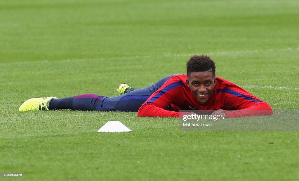 Demarai Gray of England looks on as he lies on the ground during an England Under 21 training session at St George's Park on August 30, 2017 in Burton-upon-Trent, England.
