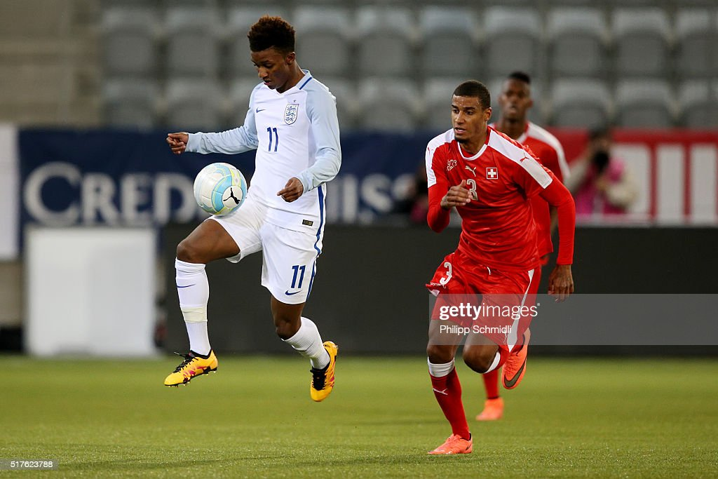 Demarai Gray of England U21 (L) competes for the ball with Martin Angha of Switzerland U21 during the European Under 21 Qualifier match between Switzerland U21 and England U21 at Stockhorn Arena on March 26, 2016 in Thun, Switzerland.