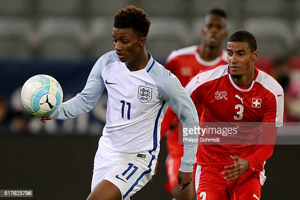 Demarai Gray of England U21 competes for the ball with Martin Angha of Switzerland U21 during the European Under 21 Qualifier match between...