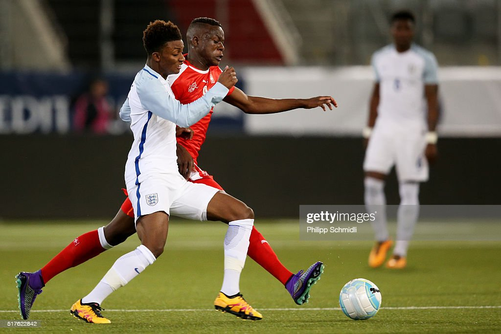 Demarai Gray of England U21 (L) fights for the ball with Denis Zakaria of Switzerland U21 during the European Under 21 Qualifier match between Switzerland U21 and England U21 at Stockhorn Arena on March 26, 2016 in Thun, Switzerland.