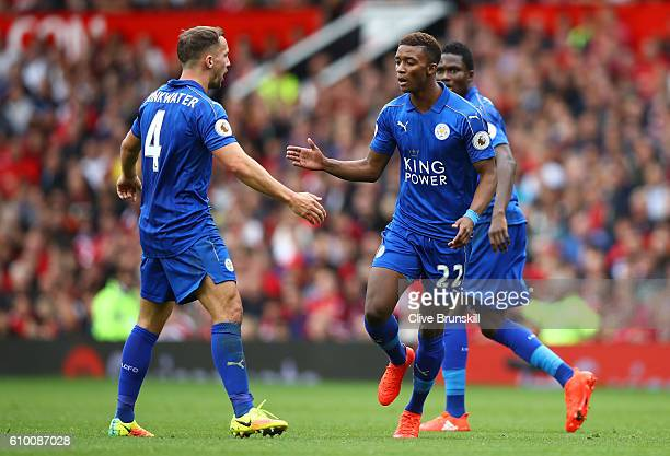 Demarai Gray of Leicester City celebrates scoring his sides first goal with Daniel Drinkwater of Leicester City during the Premier League match...