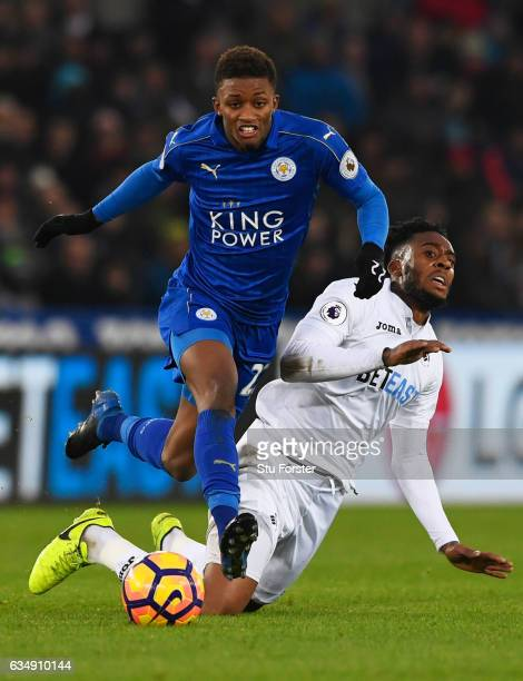 Demarai Gray of Leicester City evades Leroy Fer of Swansea City during the Premier League match between Swansea City and Leicester City at Liberty...