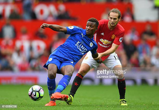 Demarai Gray of Leicester City has his shirt pulled by Daley Blind of Manchester United during the Premier League match between Manchester United and...