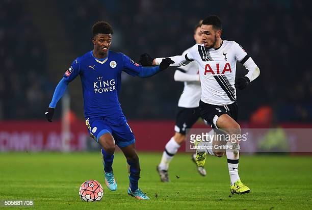 Demarai Gray of Leicester City holds off the challenge from Nabil Bentaleb of Spurs during the Emirates FA Cup Third Round Replay match between...