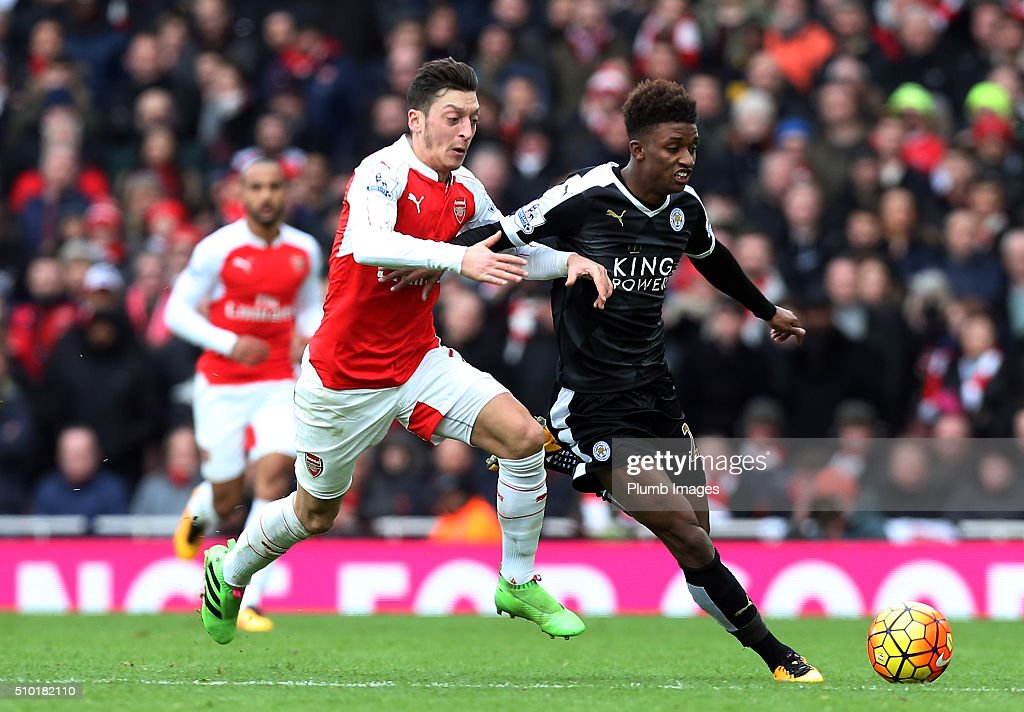 Demarai Gray of Leicester City in action with Mesut Ozil of Arsenal during the Premier League match between Arsenal and Leicester City at Emirates Stadium on February 14, 2016 in London, United Kingdom.