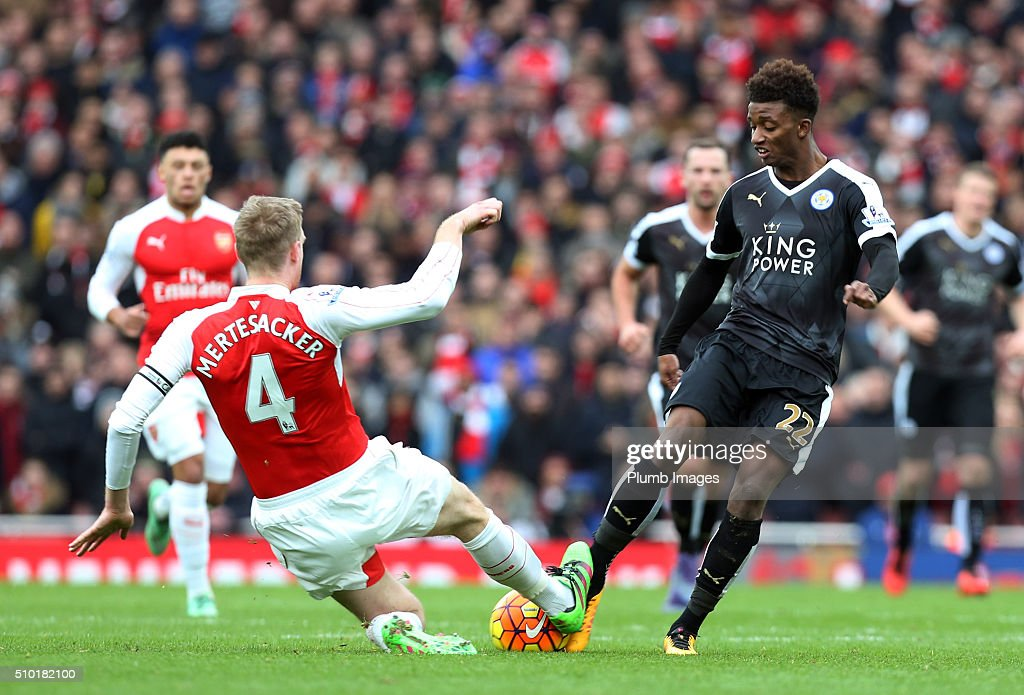 Demarai Gray of Leicester City in action with Per Mertesacker of Arsenal during the Premier League match between Arsenal and Leicester City at Emirates Stadium on February 14, 2016 in London, United Kingdom.