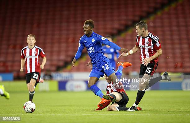 Demarai Gray of Leicester City is brought down during the checkatradecom Trophy match between Sheffield United and Leicester City at Bramall Lane on...