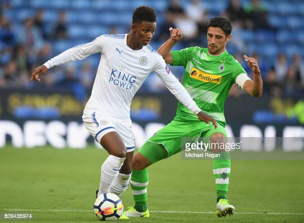 Demarai Gray of Leicester in action with Lars Stindl of Borussia Moenchengladbach during the preseason friendly match between Leicester City and...