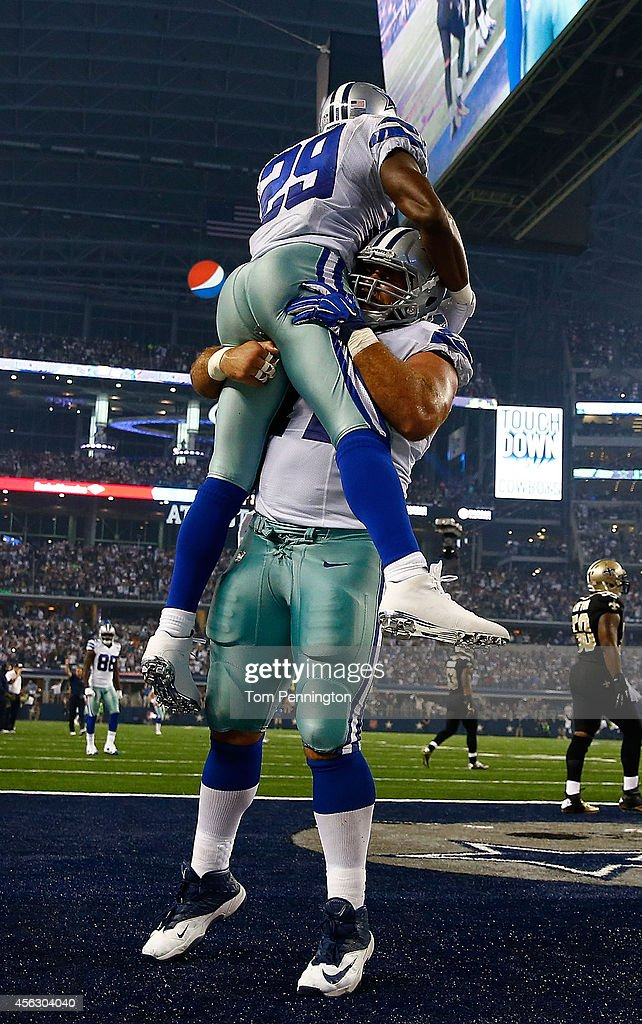 DeMarco Murray #29 of the Dallas Cowboys and Travis Frederick #72 of the Dallas Cowboys celebrate Murray's touchdown against the New Orleans Saints in the first half at AT&T Stadium on September 28, 2014 in Arlington, Texas.