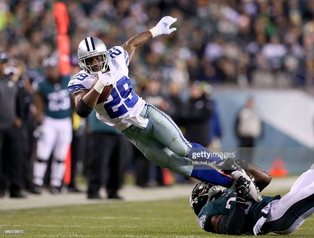 DeMarco Murray #29 of the Dallas Cowboys is tackled during the game against the Philadelphia Eagles at Lincoln Financial Field on December 14, 2014 in Philadelphia, Pennsylvania.