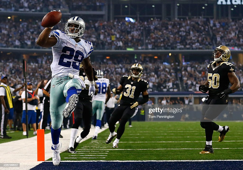 DeMarco Murray of the Dallas Cowboys runs for a touchdown against the New Orleans Saints in the first half at ATT Stadium on September 28 2014 in...