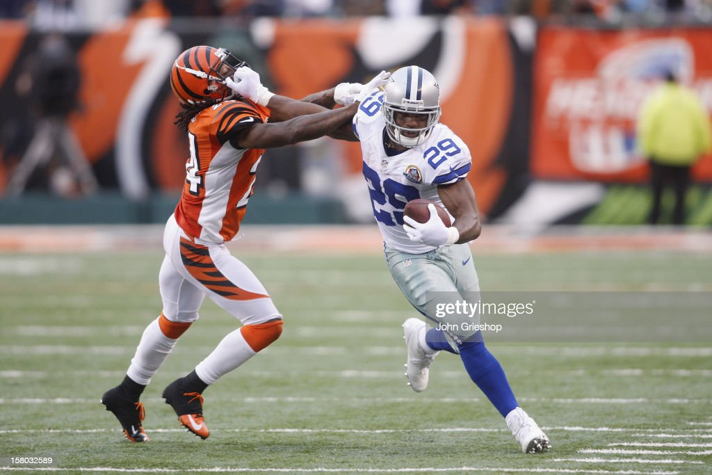 <a gi-track='captionPersonalityLinkClicked' href=/galleries/search?phrase=DeMarco+Murray&family=editorial&specificpeople=4489293 ng-click='$event.stopPropagation()'>DeMarco Murray</a> #29 of the Dallas Cowboys runs the ball upfield against Adam Jones #24 of the Cincinnati Bengals during their game at Paul Brown Stadium on December 9, 2012 in Cincinnati, Ohio. The Cowboys defeated the Bengals 20-19.