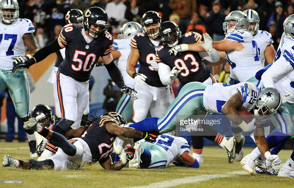 DeMarco Murray of the Dallas Cowboys scores a touchdown past Tim Jennings of the Chicago Bears during the second quarter of a game at Soldier Field...