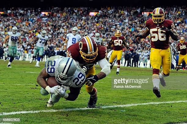DeMarco Murray of the Dallas Cowboys scores the game winning touchdown in the fourth quarter during an NFL game against the Washington Redskins at...