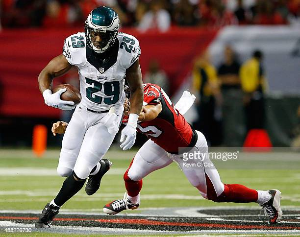 DeMarco Murray of the Philadelphia Eagles breaks a tackle by Paul Worrilow of the Atlanta Falcons during the first half at the Georgia Dome on...