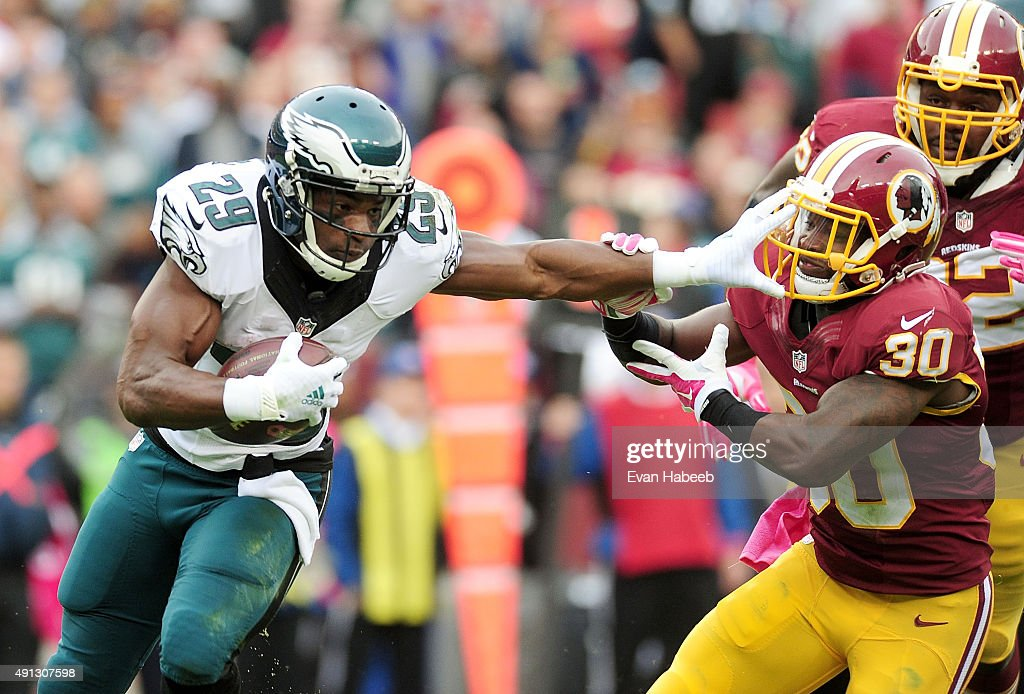 DeMarco Murray of the Philadelphia Eagles breaks the tackle of Kyshoen Jarrett of the Washington Redskins in the second quarter at FedExField on...