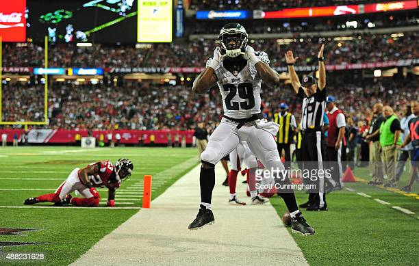 DeMarco Murray of the Philadelphia Eagles celebrates after scoring a third quarter touchdown against Robert Alford of the Atlanta Falcons at the...