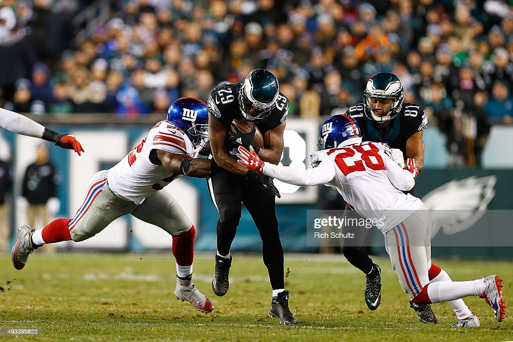 DeMarco Murray of the Philadelphia Eagles is wrapped up by Jon Beason and Jayron Hosley of the New York Giants during the fourth quarter at Lincoln...